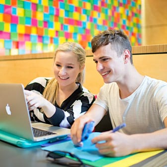 Students researching on a computer
