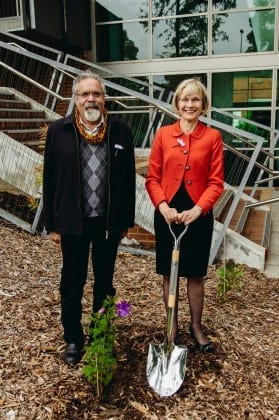 Associate Professor Simon Forrest and Vice-Chancellor Deborah Terry tree planting