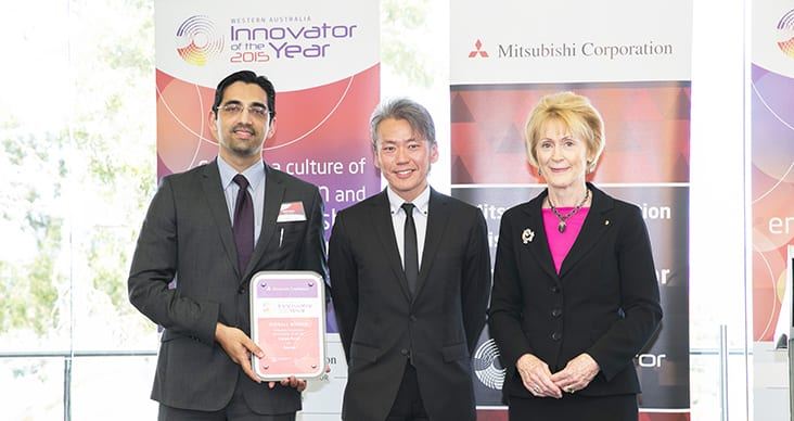 Kashif Saleem, CEO Trackem; Hero Godha, Deputy Managing Director Mitsubishi Australia; and Her Excellency the Honourable Kerry Sanderson AO, Governor of Western Australia standing together, as Mr Saleem wins the award.
