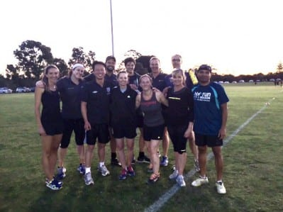 Curtin take on UWA in a mixed touch rugby game