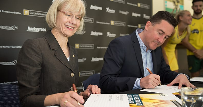 Vice Chancellor Professor Deborah Terry and Hockey Australia Cheif Executive Cam Vale signing the partnership agreement at Curtin University