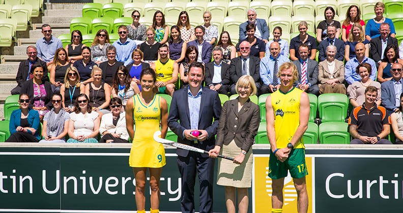 Curtin University and Hockey Australia staff and Kookaburras and Hockeyroos players at the signing