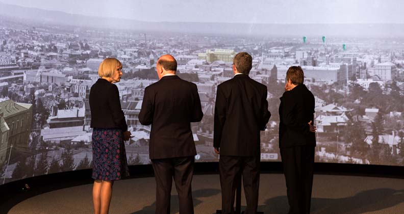 The Vice Chancellor and Minister John Day viewing the historical panoramas on the HIVE Cylinder.