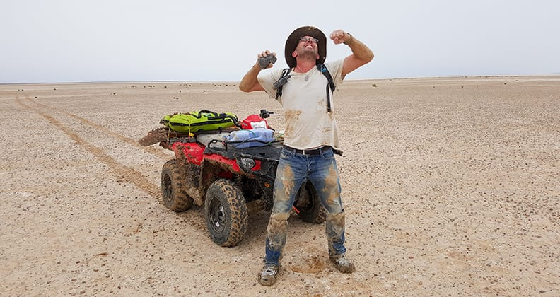 Dr Phil Bland jubilent at discovering a meteorite at Kati Thanda-Lake Eyre