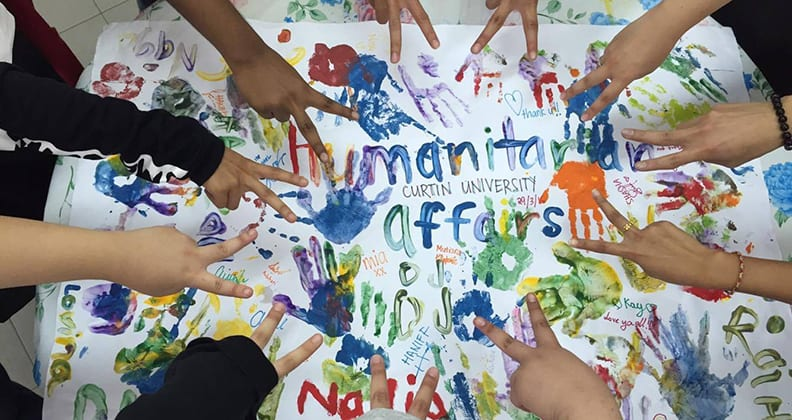 Finger painting by Humanitarian Affairs Curtin Sarawaks members