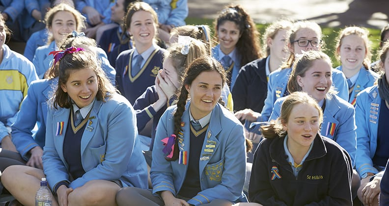 Year 12 girls from St Hilda's look surprised at the arrival of puppies.