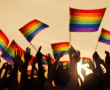 People waving LGBTIQ flags