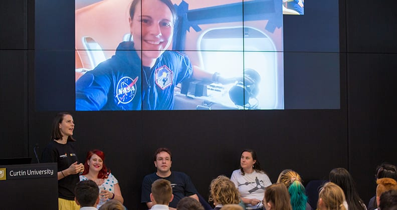 Ellie Sansom talks about her NASA experience with student from Ashdale College at the SSERVI launch.