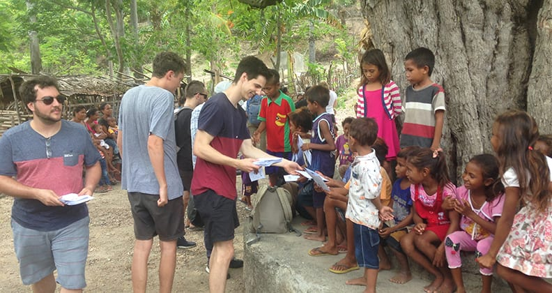 Curtin students participating in the WASH Program with children from the Liquiçá community in Timor-Leste.