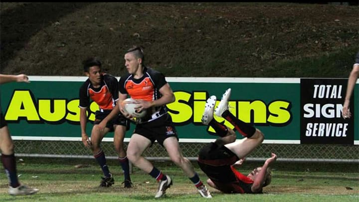Isaiah Attkins playing rugby.
