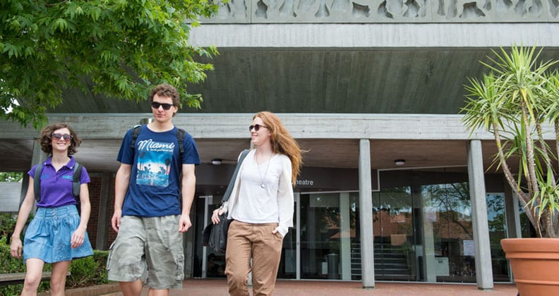 Three Curtin University students walking on the Bentley Campus