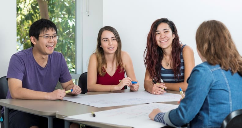Groupd of students working around a table