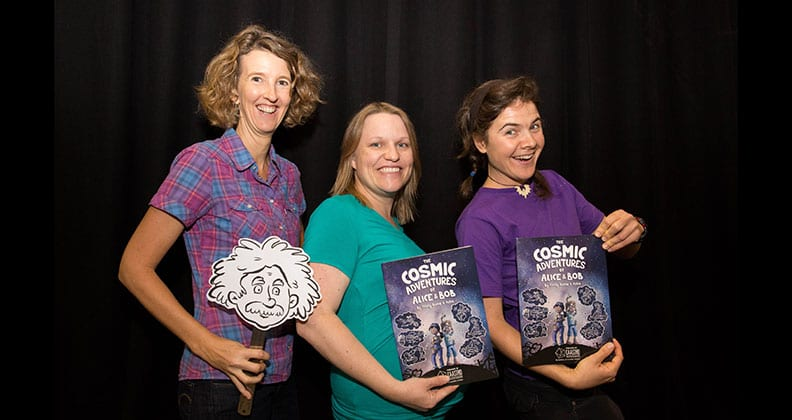 Author and science writer Cristy Burne, CAASTRO Education and Outreach Manager Dr Wiebke Ebeling, and quantum physicist and illustrator Aska with the book, The Cosmic Adventures of Alice & Bob.