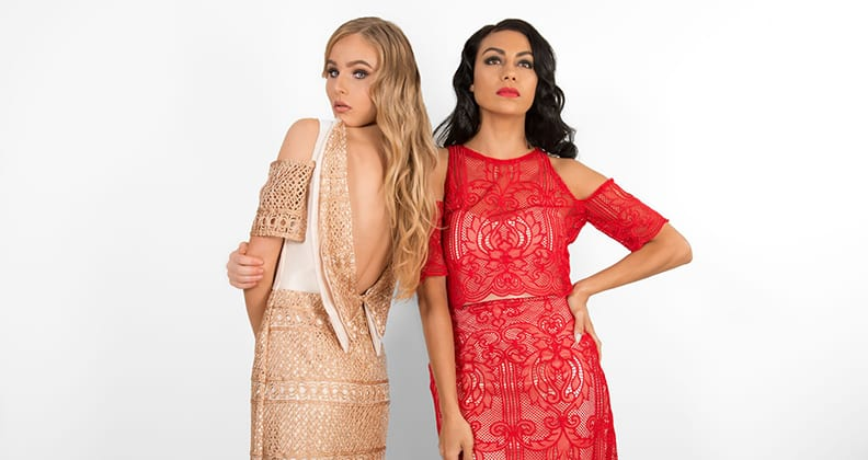 Two models wearing lace dresses.