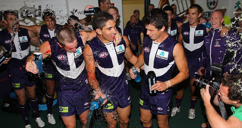 Anthony Morabito celebrates his debut for Fremantle in 2010, flanked by fellow teammates Michael Barlow and Alex Silvagni.