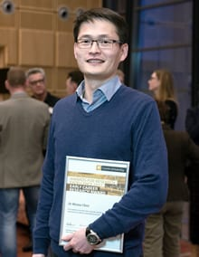 Dr Wensu Chen posing with certificate