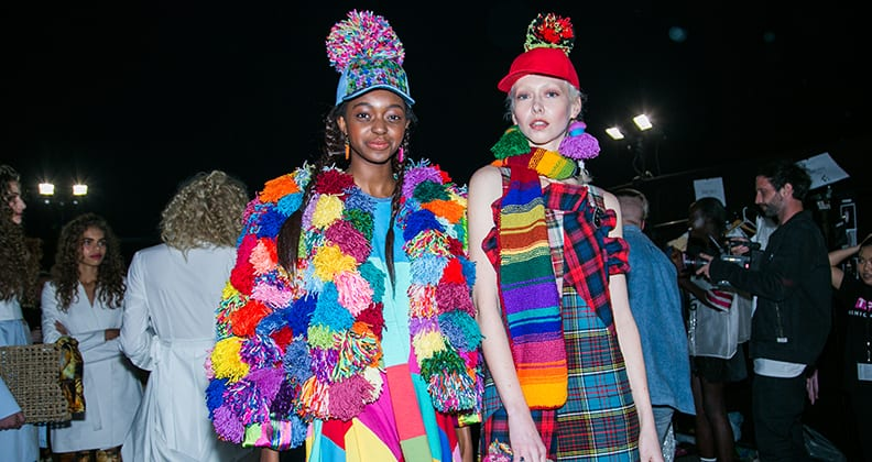 Two models wearing clothing from Kate Hannah's colourful P'JUNK collection.