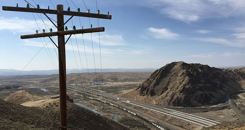 View west down the Carlin Canyon from the hill above the Carlin Tunnel in Elko County, Nevada, with an old telephone pole in the foreground.