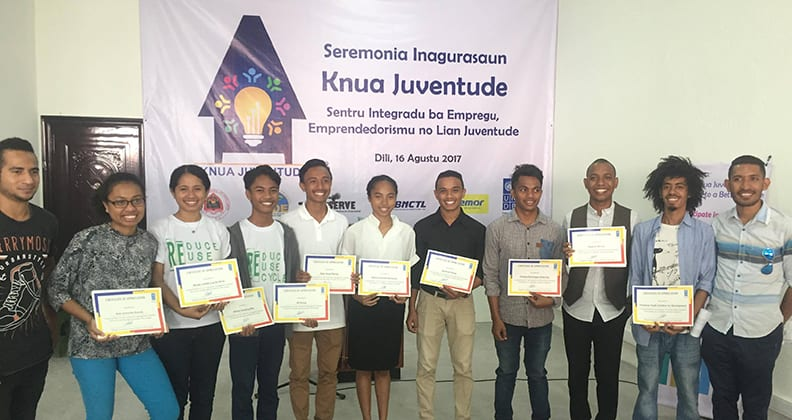 Timorese youth holding awards at the Knua Juventude youth centre.