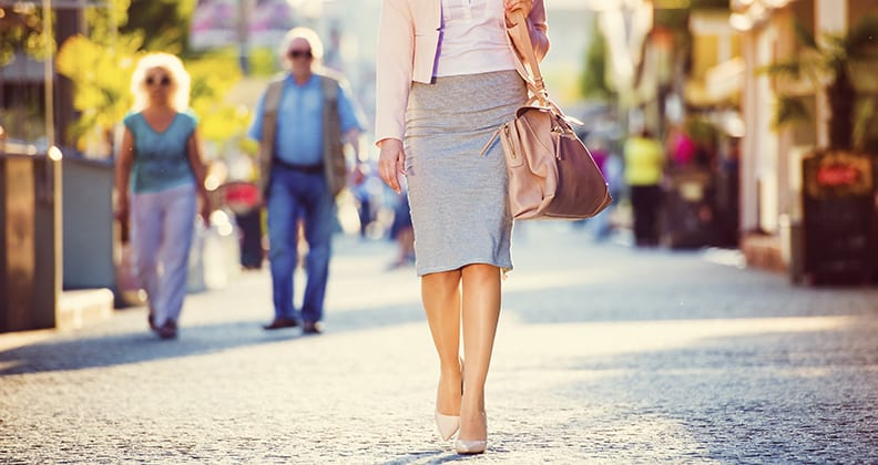 Young business woman walking in the city.