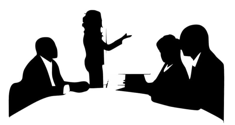 Vector image of people in a meeting room.