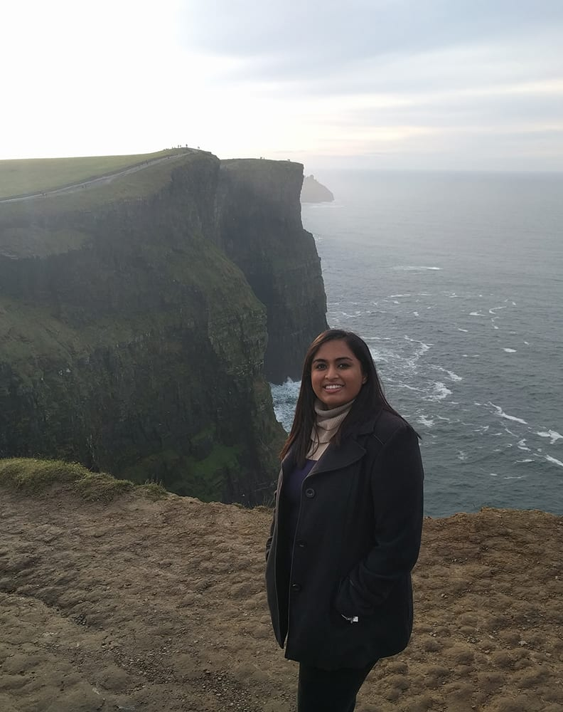 Swati standing above the Cliffs of Moher.