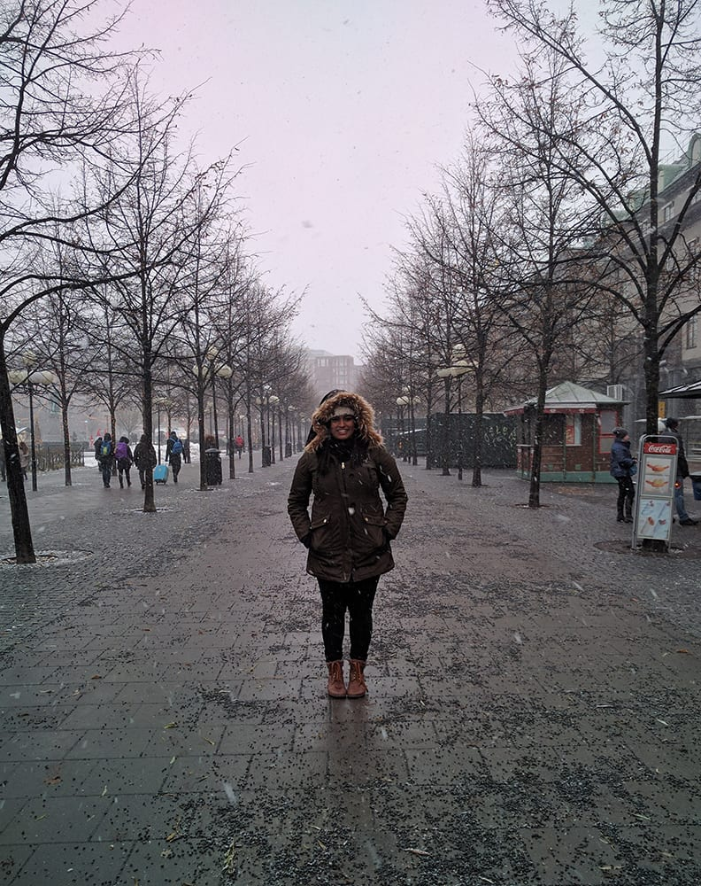 Swati with a heavy winter jacket in cold Stockholm, Sweden.