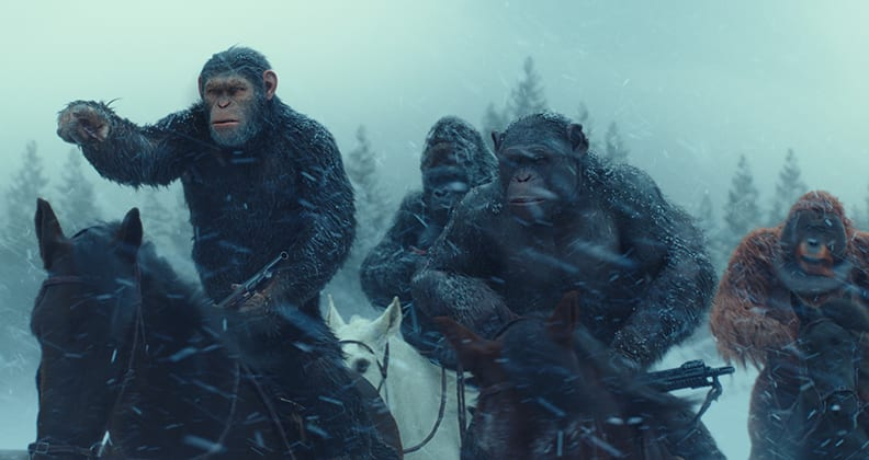 Caesar and other apes riding horses during a blizzard in War for the Planet of the Apes.