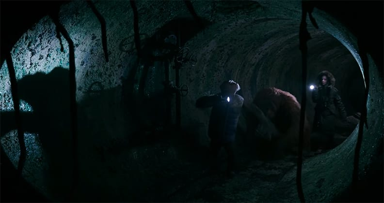 """""""Bad Ape"""", Maurice and Nova walking in a tunnel in War for the Planet of the Apes."""