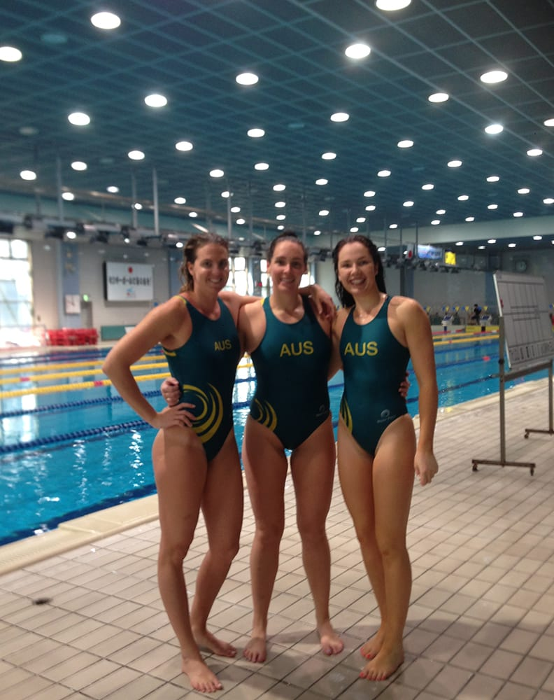 Kassia Ralston at an indoor pool with her teammates at a training camp in Japan.