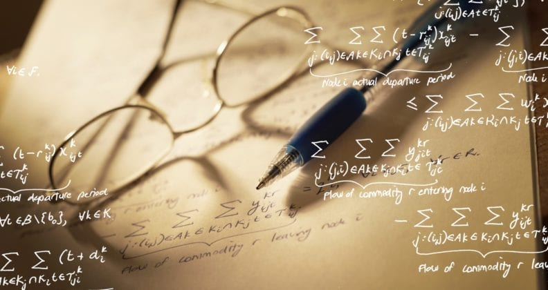 Pair of glasses and mathematical equations